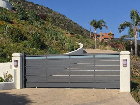 beach community glass and aluminum driveway gate