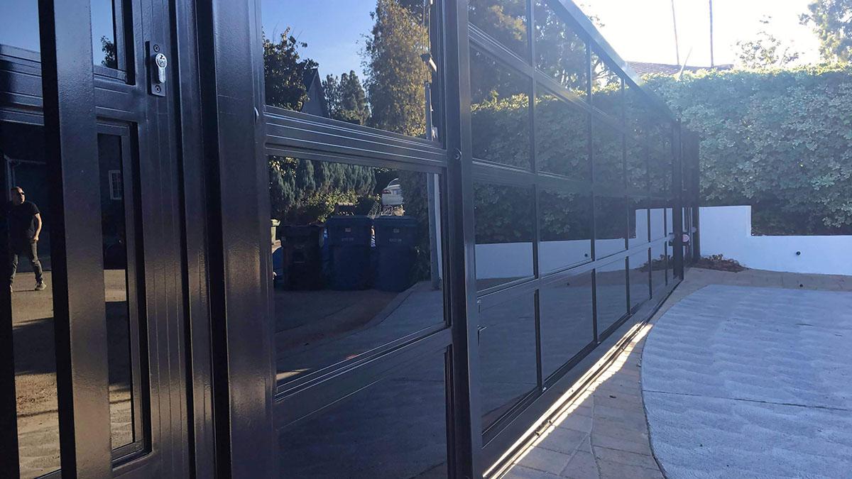 Black aluminum and glass driveway gate