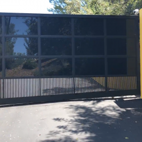 Aluminum and glass driveway gate