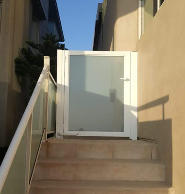White aluminum and glass entry gate
