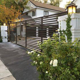 Iron driveway gate with horizontal slats