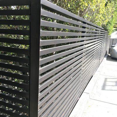 Iron fence with horizontal slats