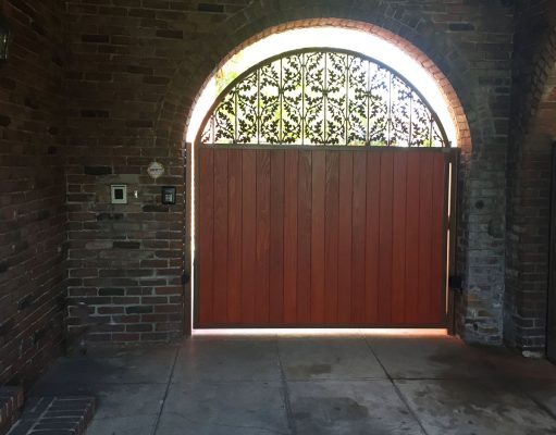 Wood entry gate with decorative iron