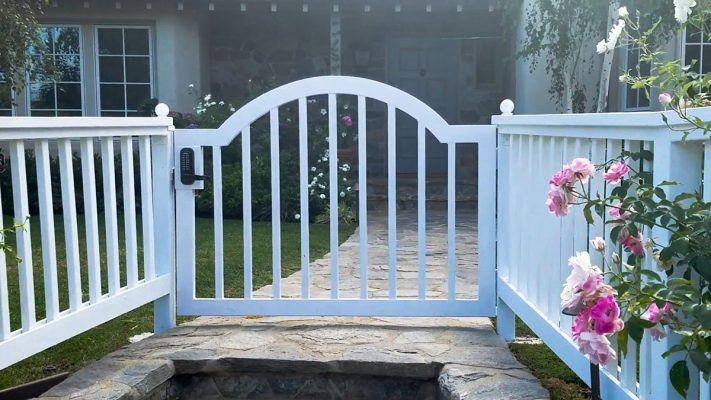 White wood entry gate with fencing