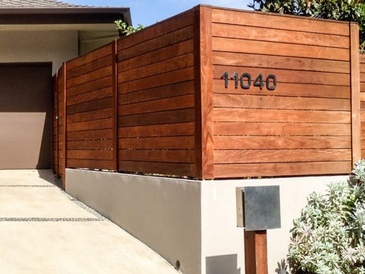 Wood fence with house number