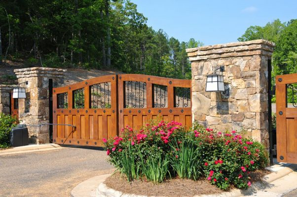 Wood driveway gate with iron accents