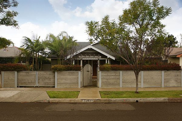 Light-colored wood fence with entryway