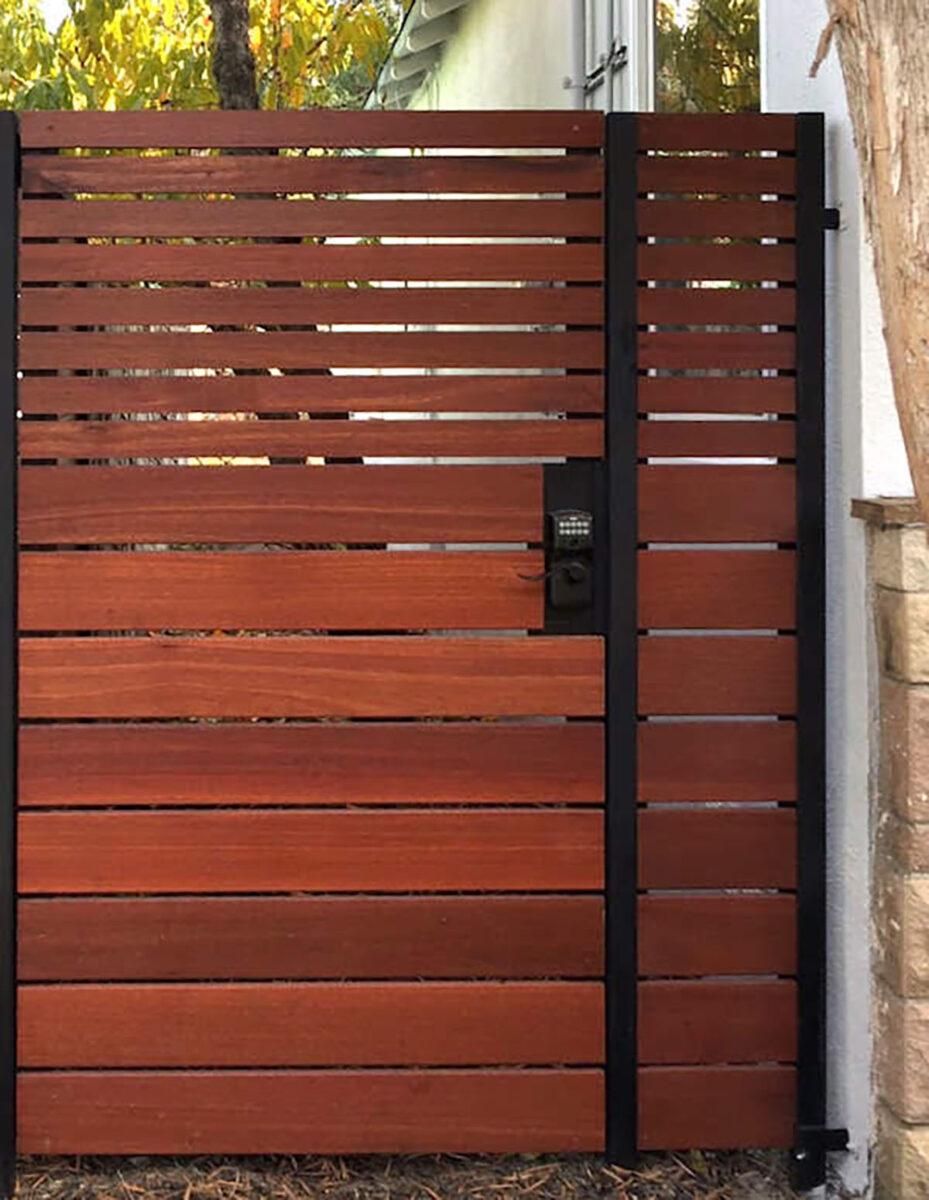 Horizontal slated wood gate with keypad entry